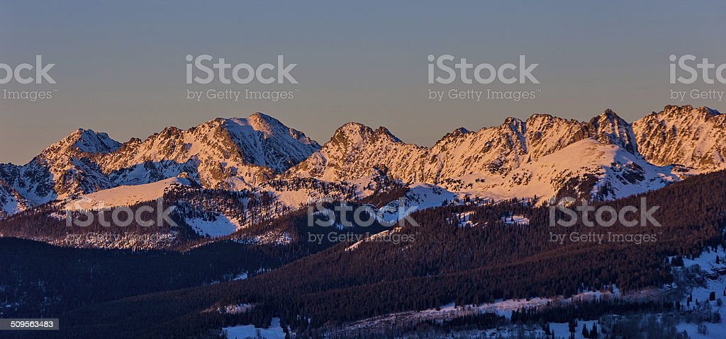 Gore Range Mountains at Sunset with Alpenglow stock photo
