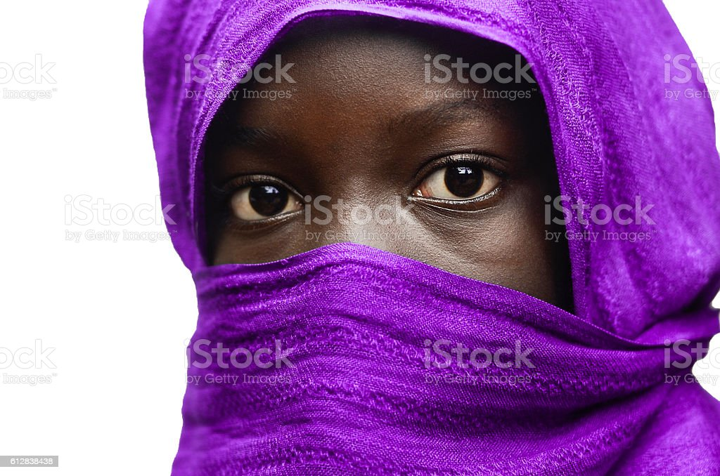 Gorgeous African Girl Hidden by Violet Head Scarf Outdoors (Isolated) stock photo