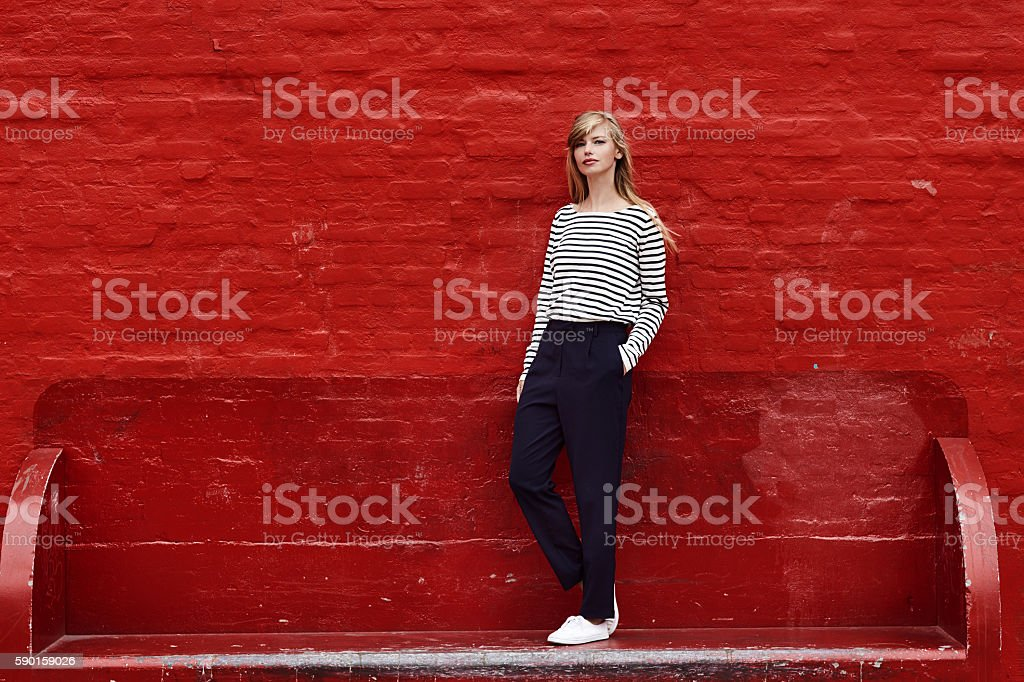 Gorgeous against red stock photo