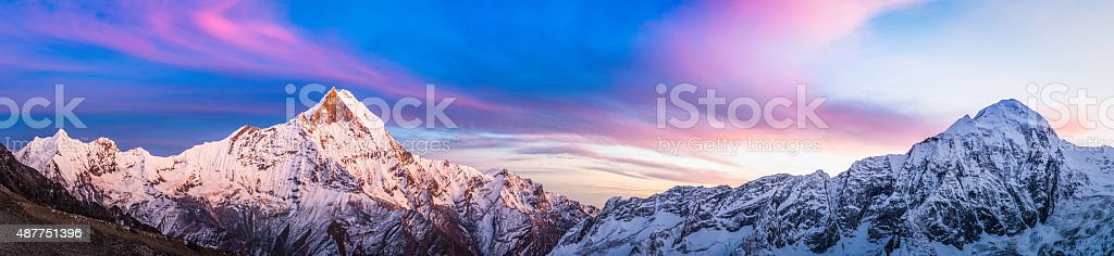 Gorgeous alpenglow sunset snowy peaks panorama Annapurna Sanctuary Himalayas Nepal stock photo