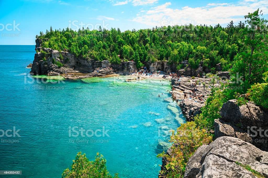 Gorgeous amazing natural rocky beach view and tranquil azure water stock photo