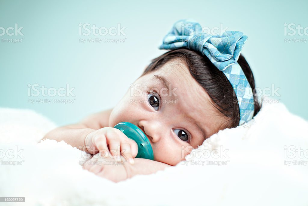 Gorgeous baby girl laying on blanket royalty-free stock photo