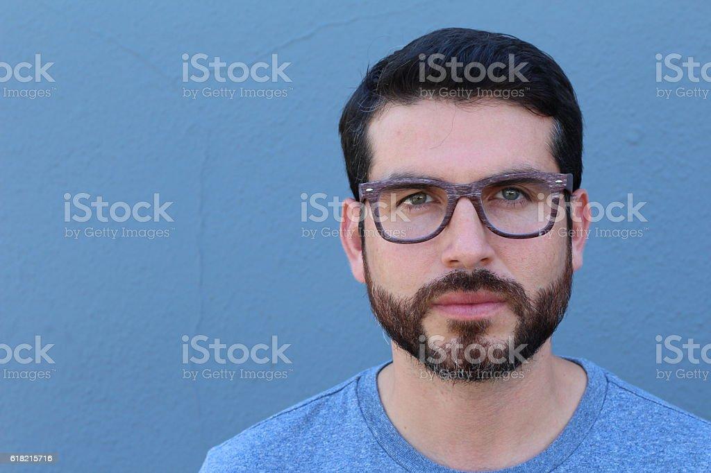 Gorgeous bearded brunette guy wearing glasses stock photo