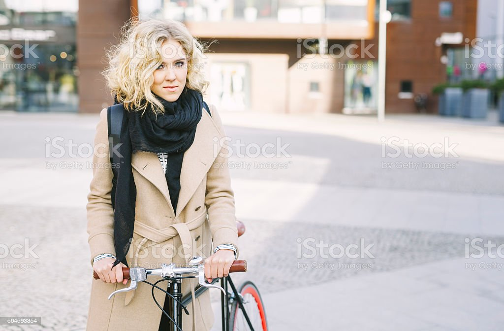 Gorgeous Blond Girl Hanging Out In The City With Bicycle stock photo