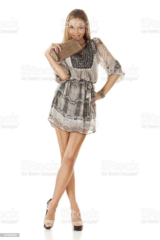 Gorgeous blonde posing in mini dress stock photo