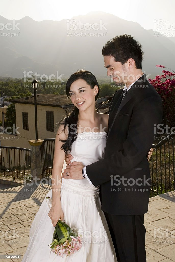 gorgeous bride and groom under a sunset royalty-free stock photo