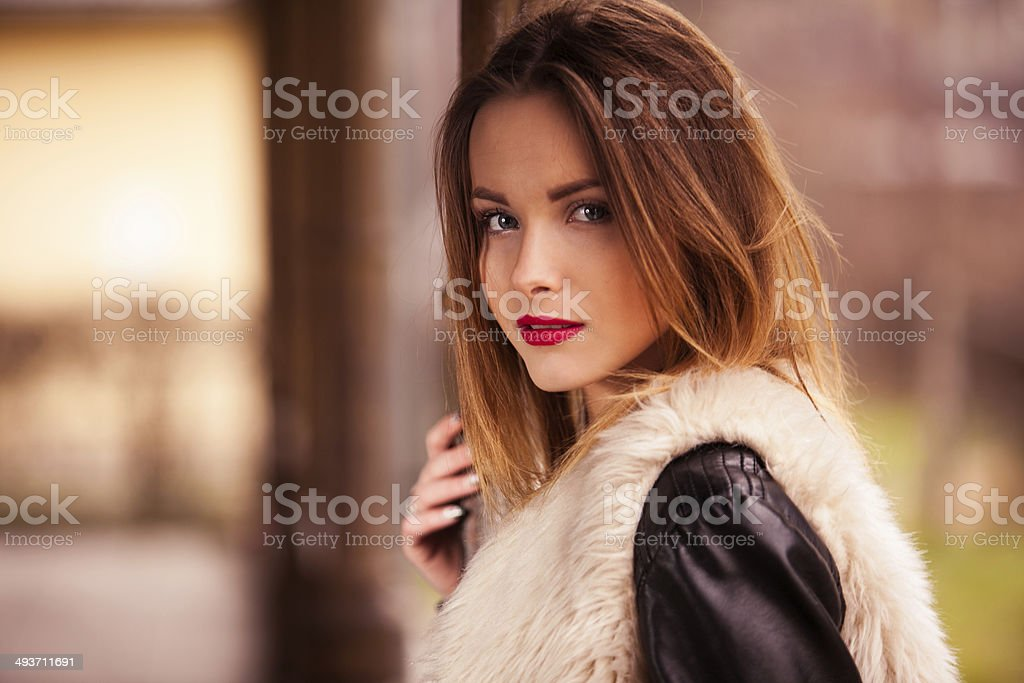 Gorgeous brunette standing on the train station portrait stock photo