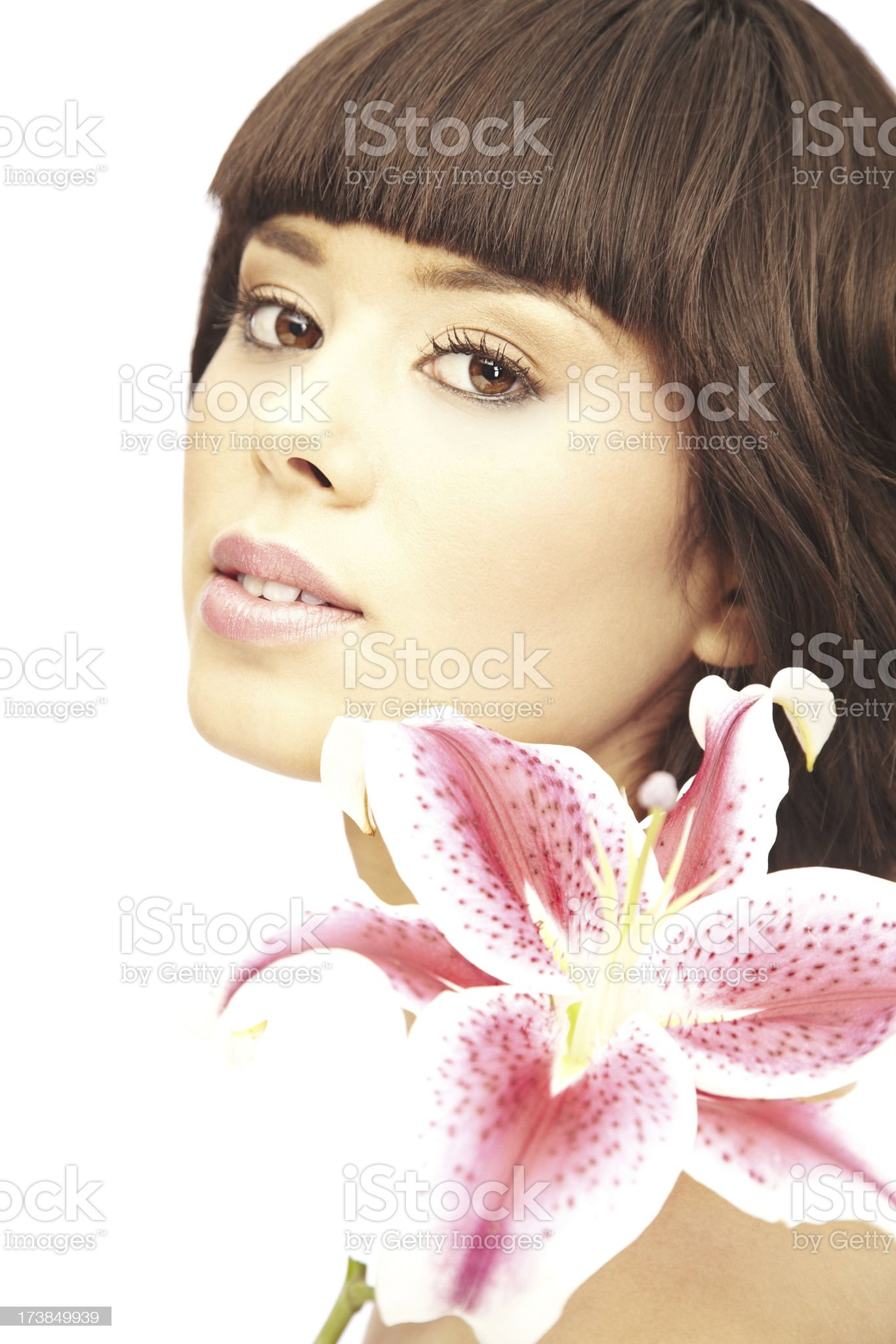 Gorgeous Brunette Woman with Stargazer Lily. Isolated. royalty-free stock photo