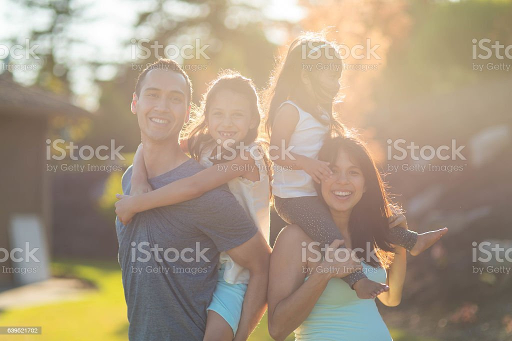 Gorgeous ethnic family spending time together outdoors stock photo