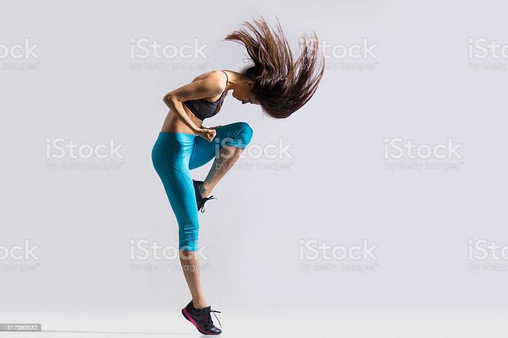 Gorgeous girl dancing stock photo