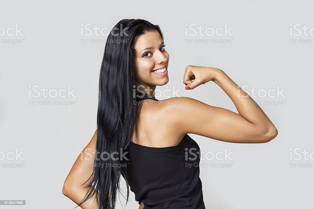 Gorgeous girl showing biceps stock photo