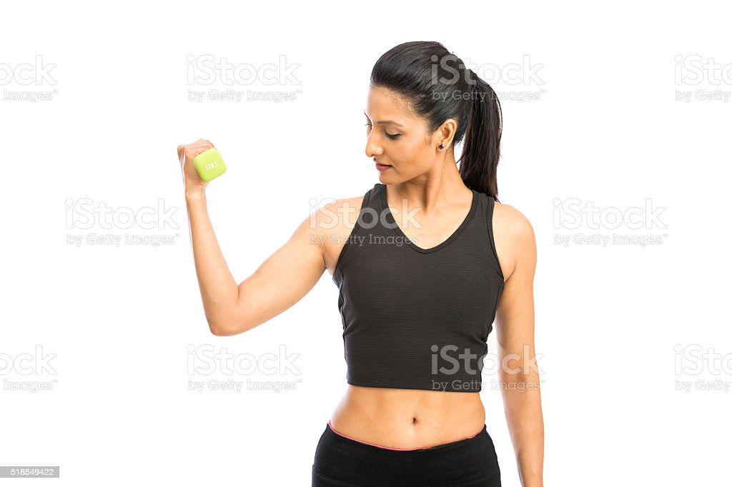 Gorgeous healthy blonde lifting weights stock photo