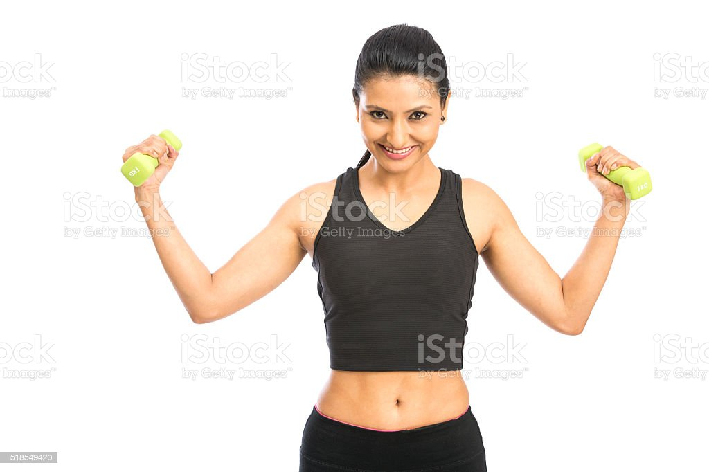 Gorgeous healthy young girl lifting weights stock photo