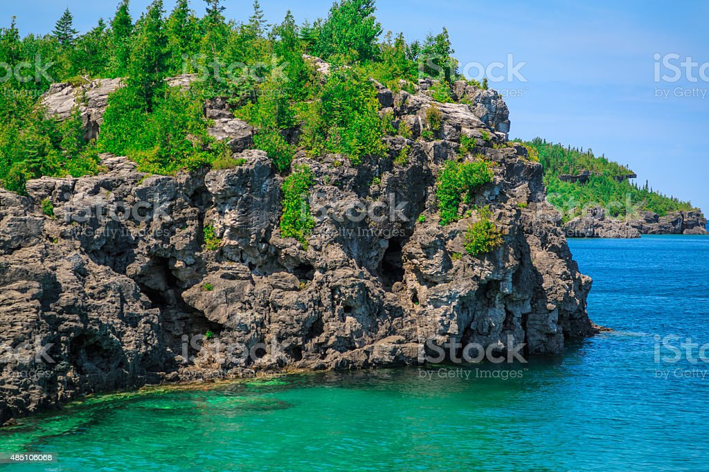 gorgeous landscape view with cliffs rocks above great Huron lake stock photo