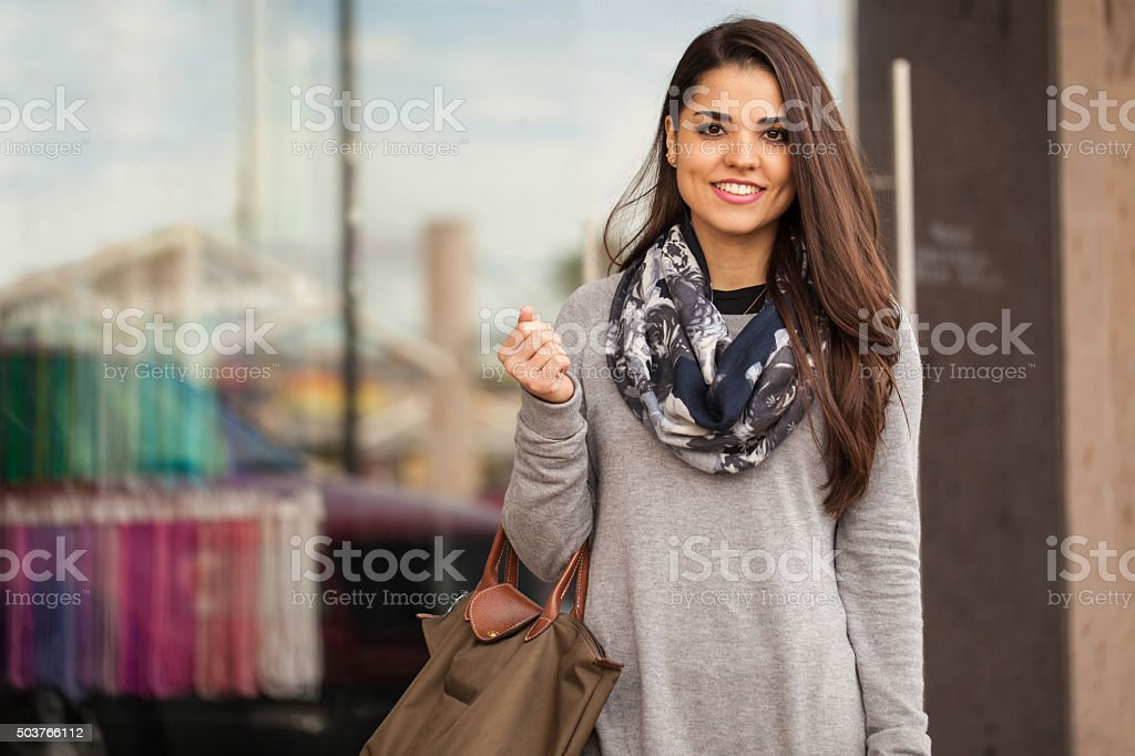 Gorgeous Latin brunette at a shopping center stock photo