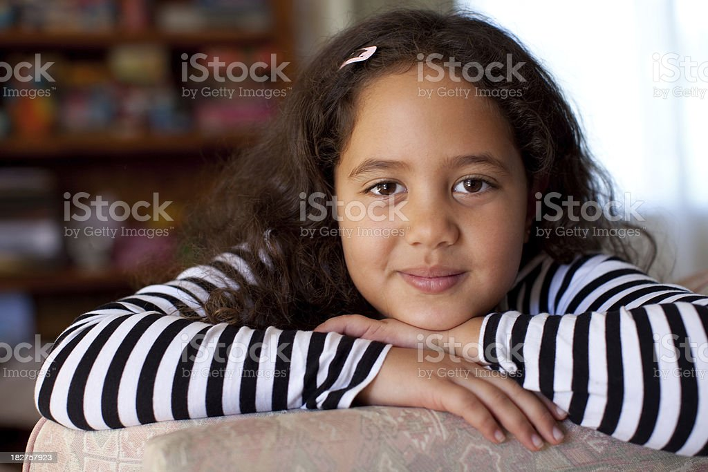 Gorgeous Little Girl with dark skin and brown hair stock photo