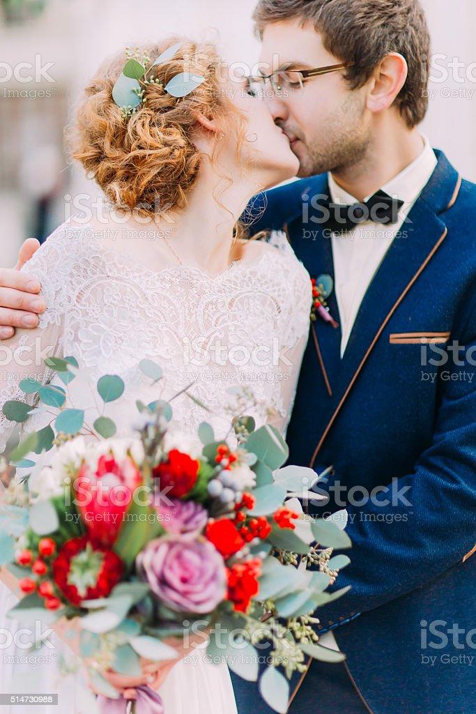 Gorgeous newlyweds tenderly kissing on wedding ceremony stock photo