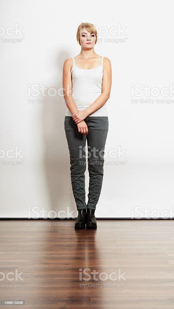 Gorgeous pretty woman in sleeveless shirt. stock photo