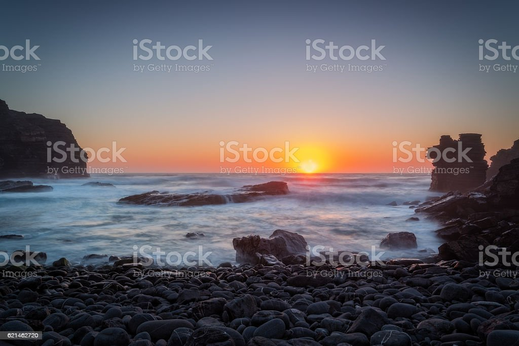 Gorgeous sunset on the stone beach. stock photo