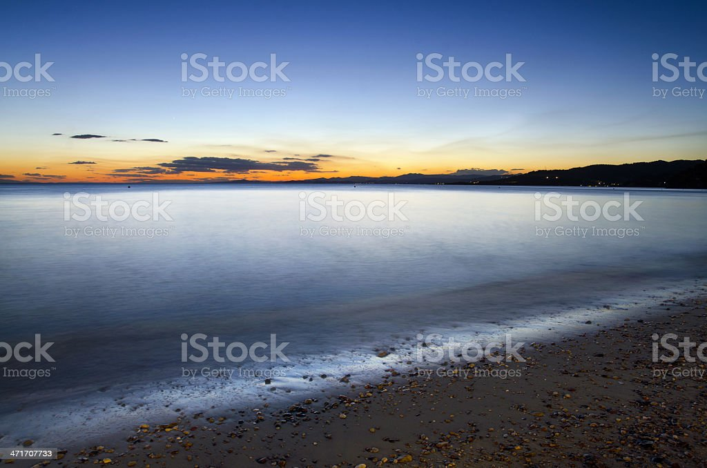 gorgeous sunset over the sea and waves stock photo