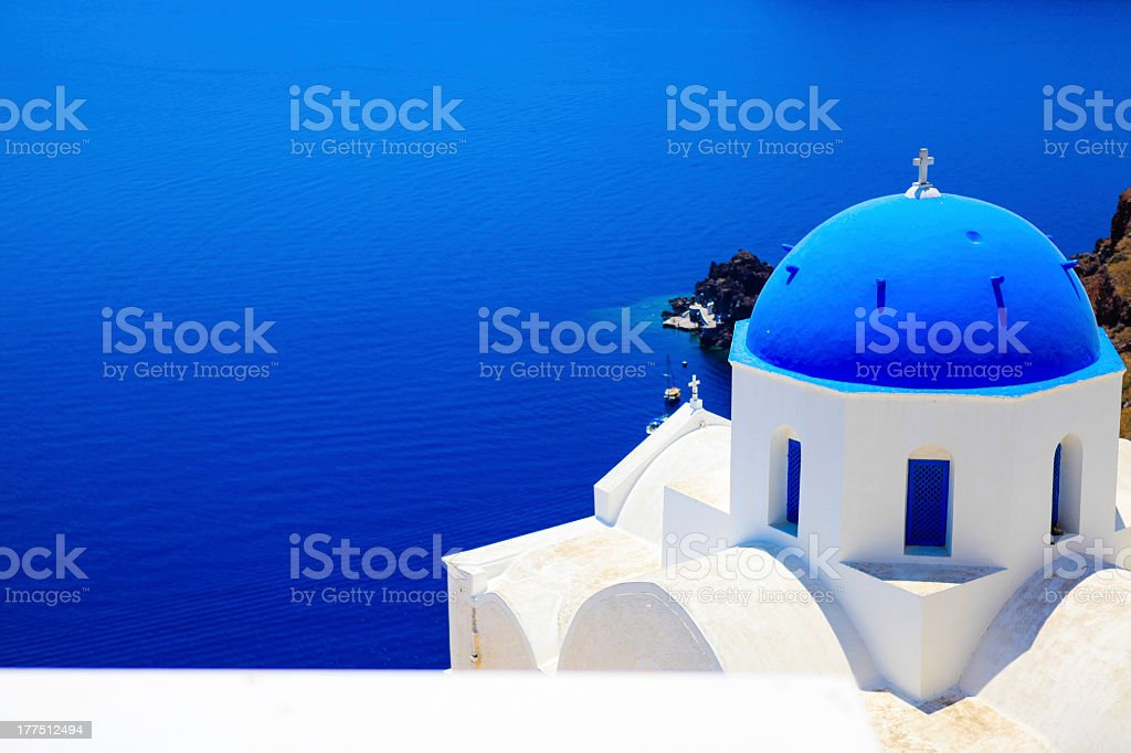 A gorgeous view of a quant church and the deep blue sea  stock photo
