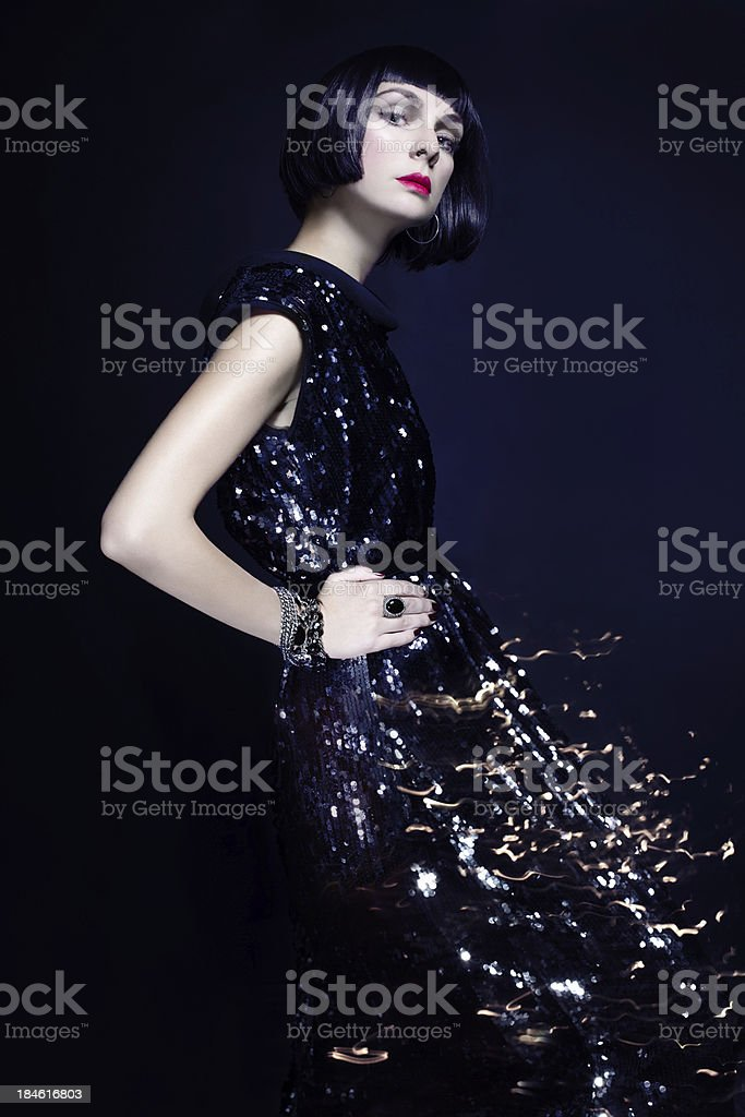 Gorgeous vintage woman in glittering dress royalty-free stock photo