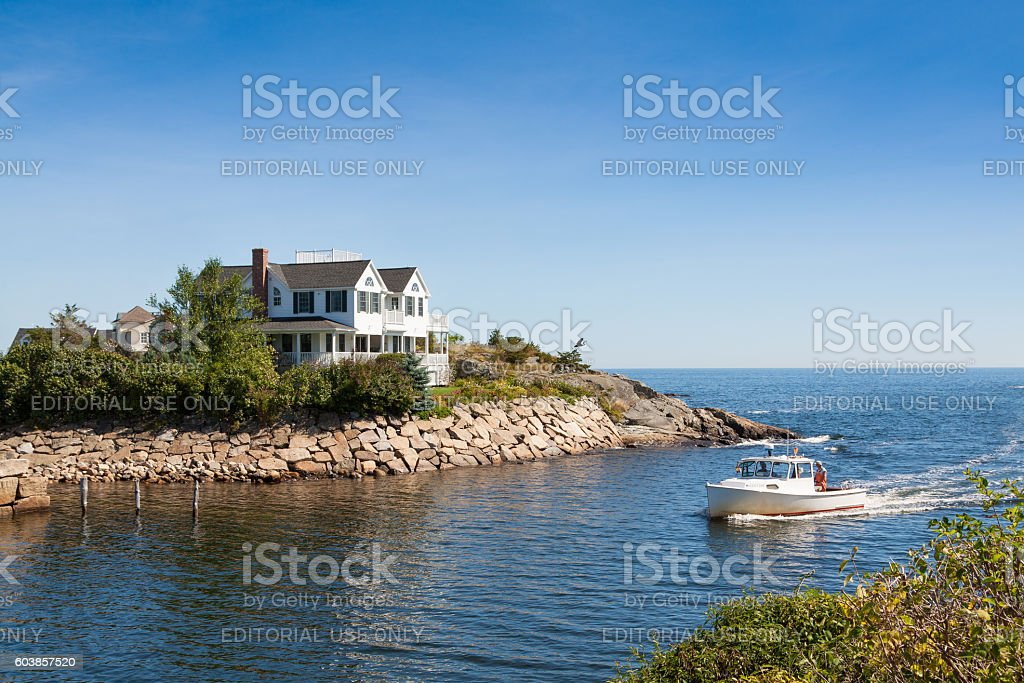 Gorgeous Waterfront House, Rocky Shore and Fishing Boat, Ogunquit, Maine. stock photo