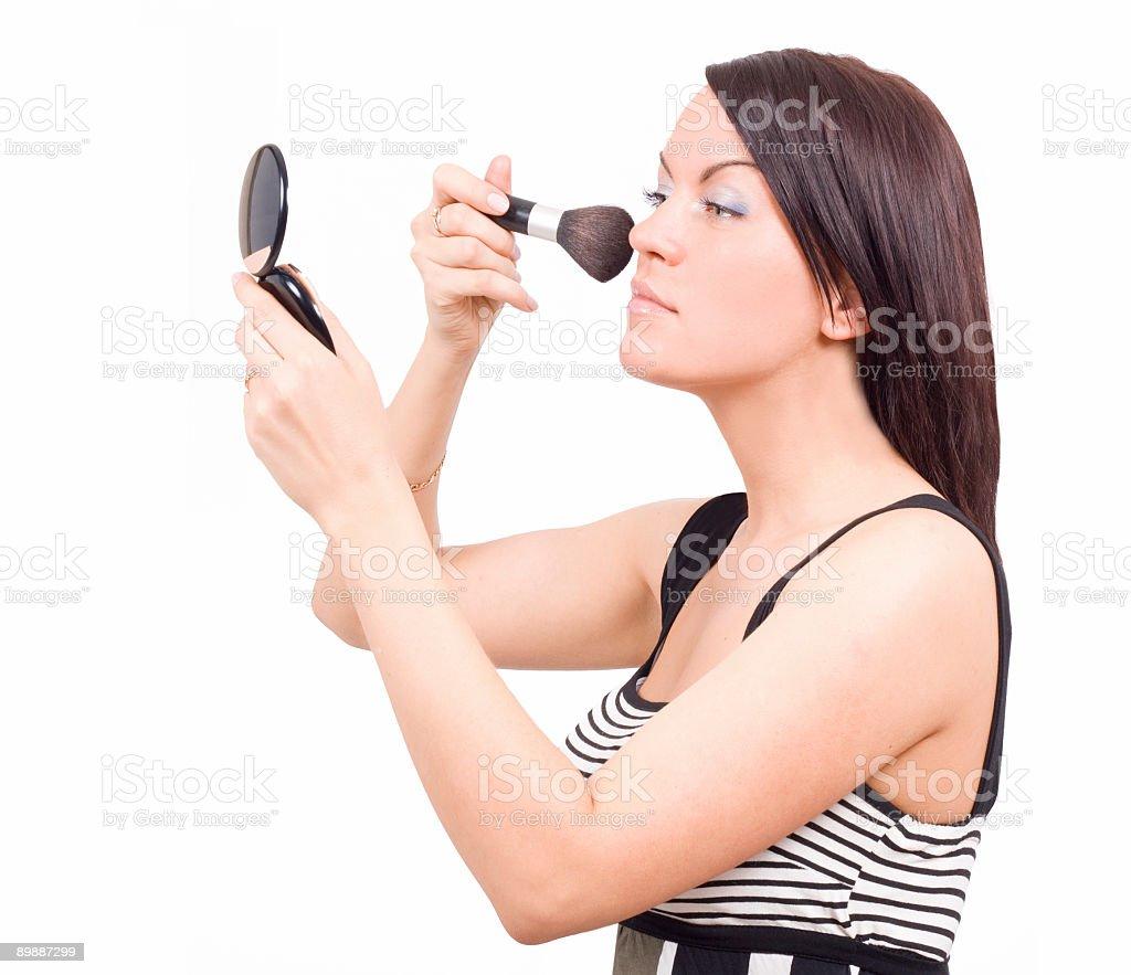 gorgeous woman applying makeup royalty-free stock photo