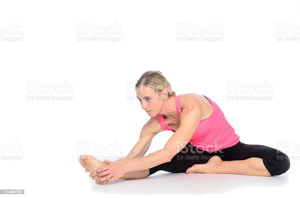Gorgeous woman doing hamstring stretch stock photo