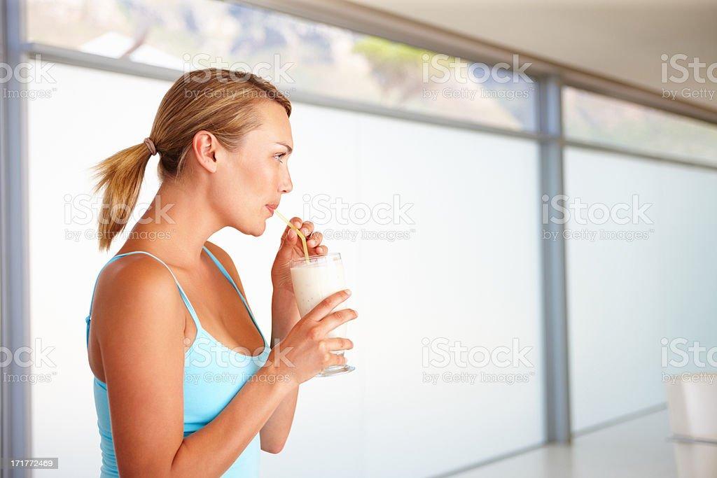 Gorgeous woman drinking a milkshake royalty-free stock photo