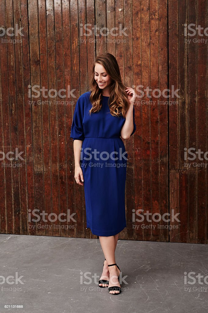 Gorgeous woman in blue dress, looking down stock photo