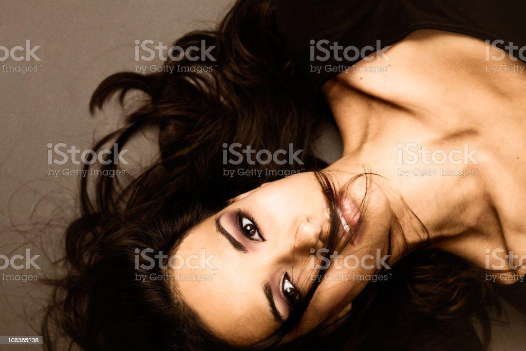 Gorgeous woman laying down  with hair lock _ horizontal. stock photo