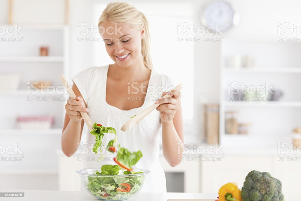Gorgeous woman mixing a salad royalty-free stock photo