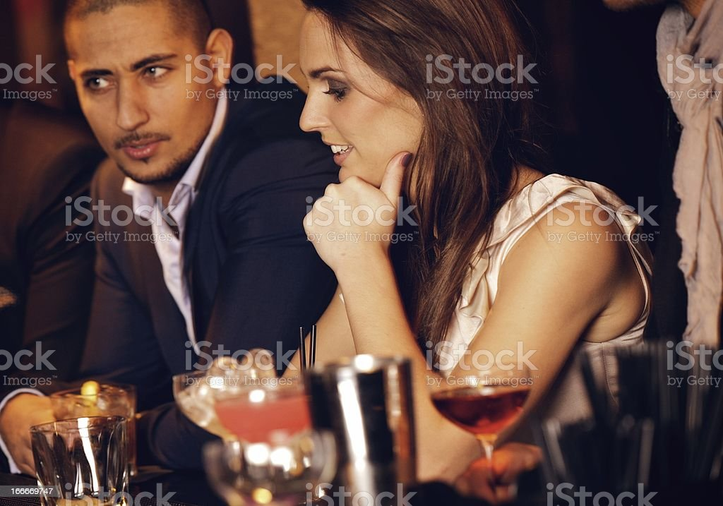 Gorgeous Woman with Boyfriend at the Bar royalty-free stock photo
