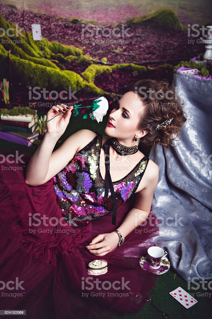 Gorgeous woman with white flower in the hand stock photo