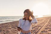 Gorgeous young bohemian brunette on the beach