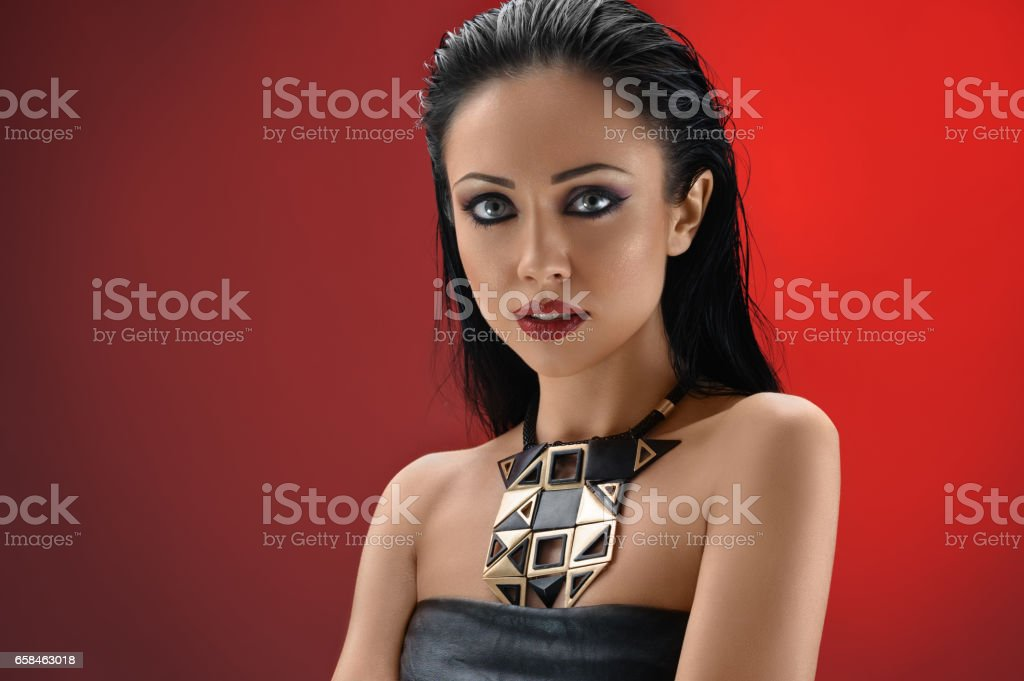 Gorgeous young brunette woman posing at studio stock photo