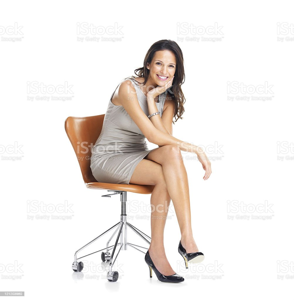 Gorgeous young businesswoman sitting on a chair stock photo