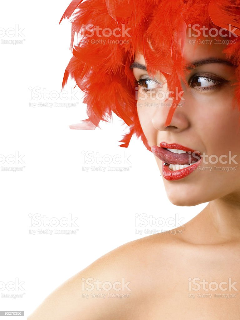 Gorgeous young girl in red feathers royalty-free stock photo