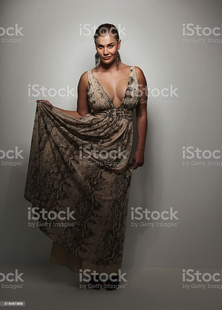 Gorgeous young lady in beautiful evening gown stock photo