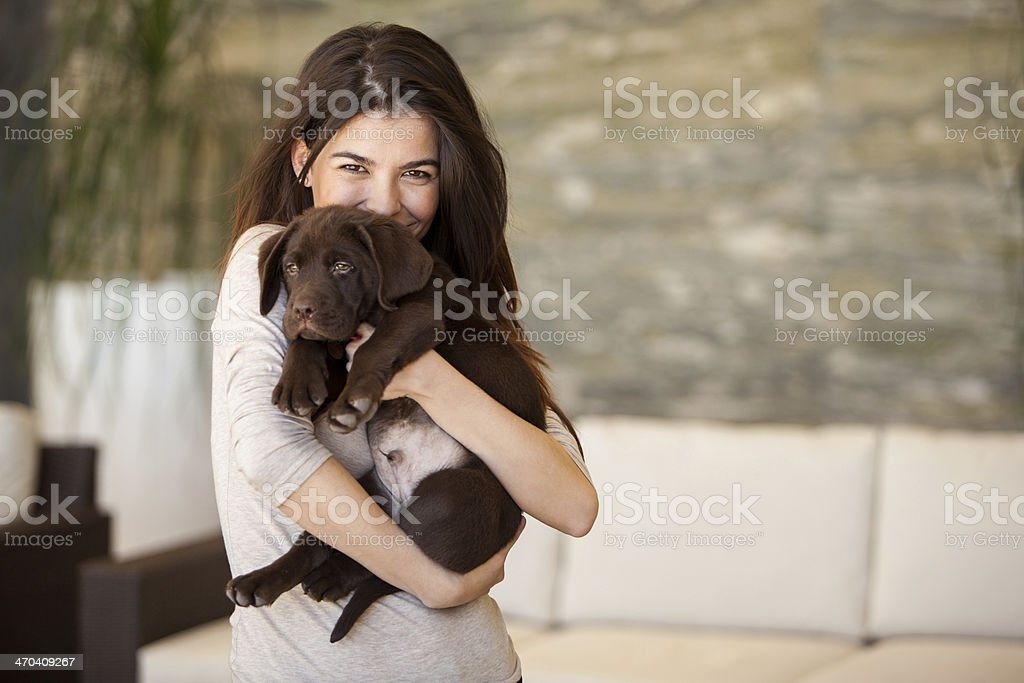 Gorgeous young woman and her puppy stock photo