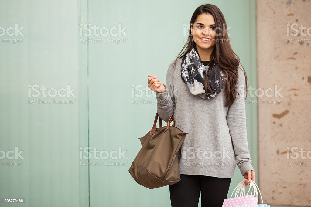 Gorgeous young woman at a shopping center stock photo