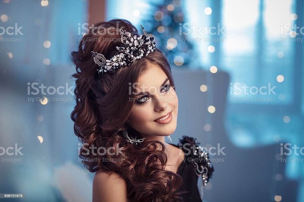 Gorgeous young woman in black dress with perfect makeup stock photo