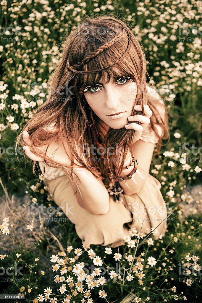 Gorgeous Young Woman in Field of Flowers royalty-free stock photo