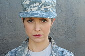 Gorgeous young woman in military outfit