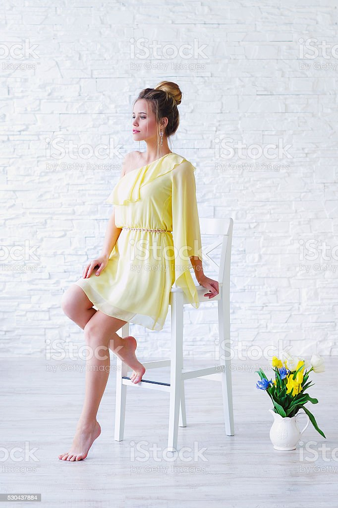 Gorgeous young woman in yellow dress stock photo