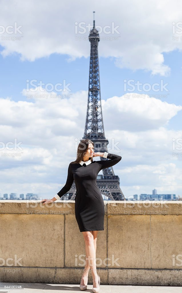 Gorgeous Young Woman Near Eiffel Tower On A Sunny Day stock photo