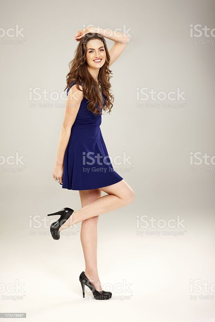 Gorgeous young woman posing over grey background stock photo