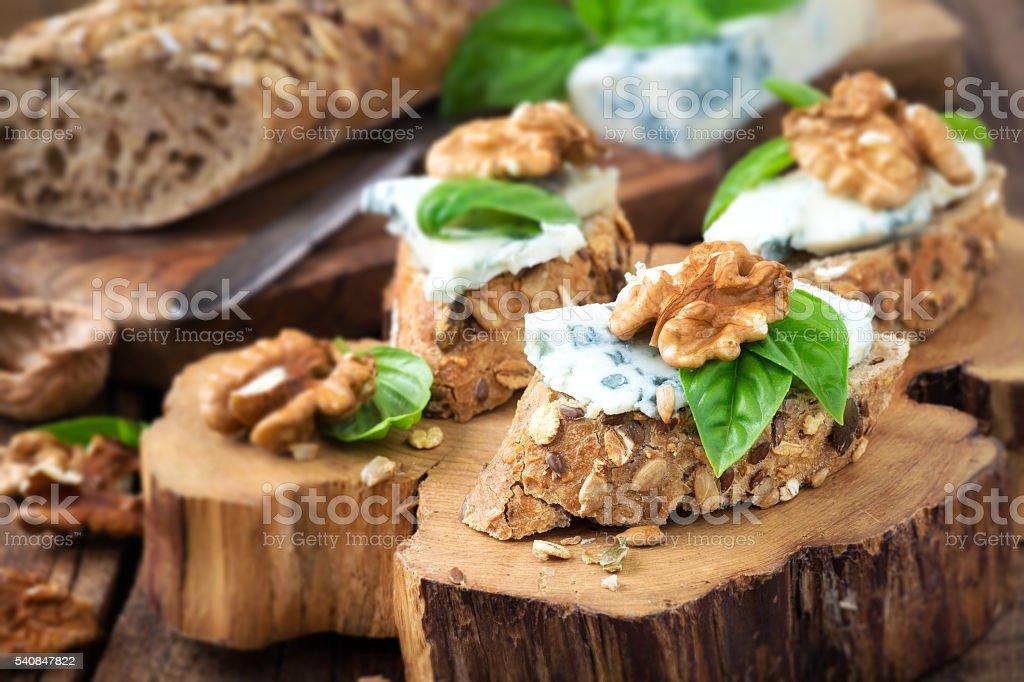 Gorgonzola and walnut canapes stock photo