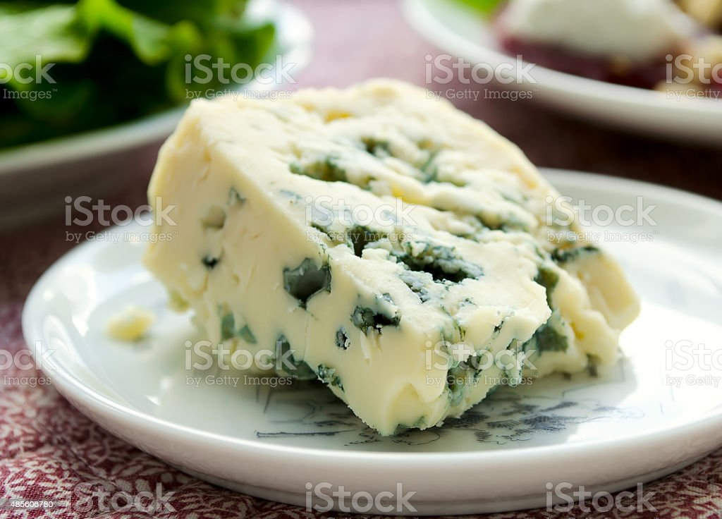 gorgonzola cheese on white plate stock photo